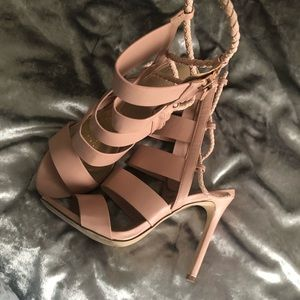 Aldo light pink zip up ankle heels.